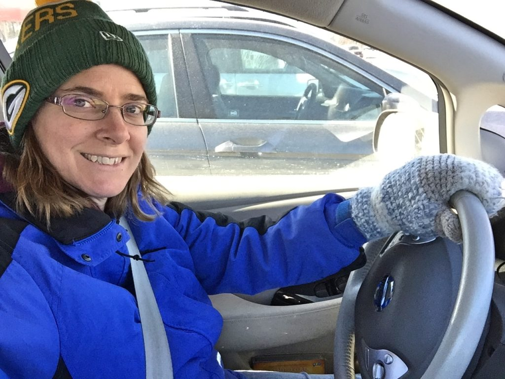 Kate bundled up to stay warm in the Nissan Leaf